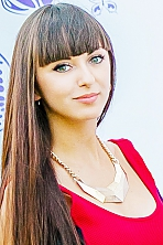 Ukrainian girl Anastasia,25 years old with grey eyes and dark brown hair.