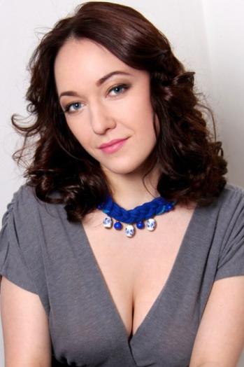 Ukrainian girl Elena,28 years old with green eyes and dark brown hair.