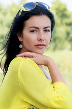 Ukrainian girl Anna,33 years old with brown eyes and black hair.