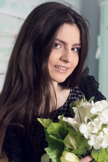 Ukrainian girl Elena,18 years old with brown eyes and black hair.