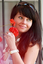 Russian girl Alla,44 years old with green eyes and dark brown hair.