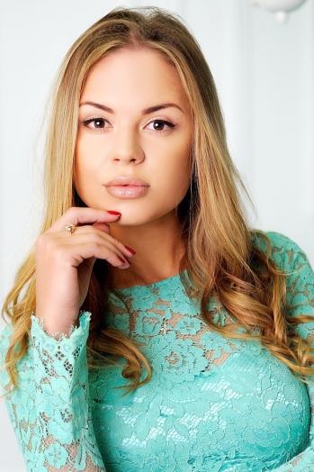Ukrainian girl Julia,25 years old with brown eyes and blonde hair.