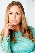 Ukrainian girl Julia,26 years old with brown eyes and blonde hair.
