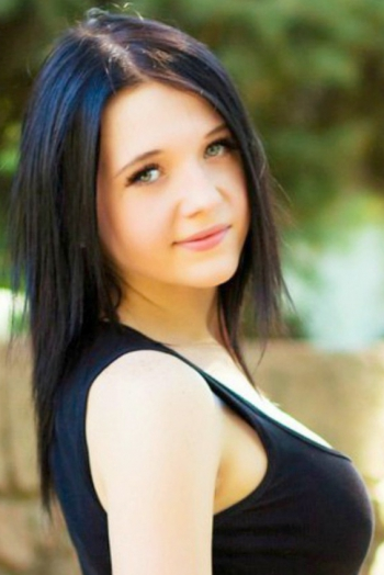 Ukrainian girl Victoria,20 years old with green eyes and black hair.