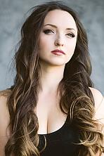 Ukrainian girl Tatyana,28 years old with green eyes and dark brown hair.