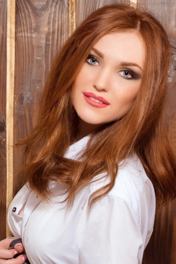 Ukrainian girl Viktoria,25 years old with blue eyes and red hair.