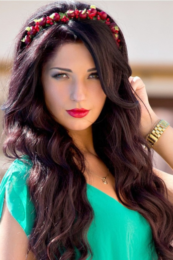 Ukrainian girl Nataliya ,22 years old with green eyes and black hair.