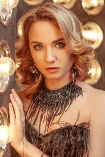 Ukrainian girl Anastasia,25 years old with grey eyes and blonde hair.