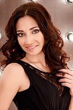Ukrainian girl Julia,34 years old with hazel eyes and dark brown hair.