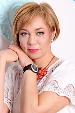 Ukrainian girl Anya,45 years old with blue eyes and dark brown hair.