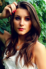 Belarusian girl Tanya,20 years old with blue eyes and dark brown hair.