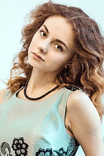 Russian girl Anna,20 years old with brown eyes and dark brown hair.