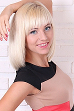 Ukrainian girl Inna,29 years old with blue eyes and blonde hair.