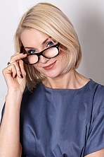 Ukrainian girl Zhanna,43 years old with blue eyes and blonde hair.