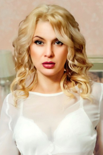 Ukrainian girl Natali,37 years old with blue eyes and blonde hair.