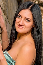 Ukrainian girl Marina,21 years old with green eyes and black hair.