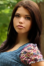 Ukrainian girl Anastasia,24 years old with green eyes and light brown hair.
