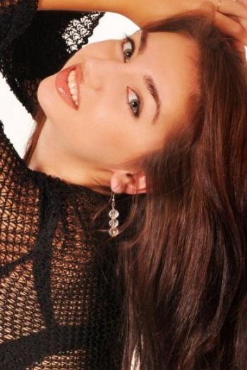 Ukrainian girl Oksana,25 years old with hazel eyes and black hair.