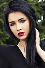 Ukrainian girl Elena,23 years old with hazel eyes and black hair.