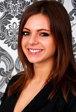 Ukrainian girl Olga,24 years old with hazel eyes and dark brown hair.