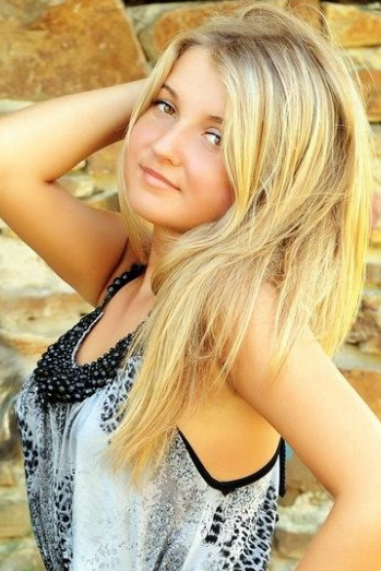 Ukrainian girl Julia,25 years old with brown eyes and light brown hair.