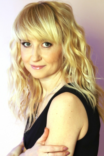 Ukrainian girl Lyudmila,47 years old with green eyes and blonde hair.