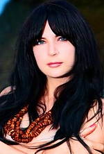 Ukrainian girl Inna,32 years old with hazel eyes and black hair.