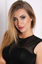 Ukrainian girl Olga,25 years old with green eyes and light brown hair.