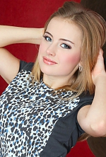 Ukrainian girl Margarita,25 years old with grey eyes and blonde hair.