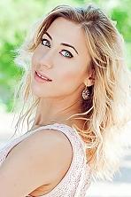 Ukrainian girl Olga,32 years old with grey eyes and blonde hair.