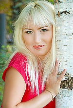 Ukrainian girl Natalia,45 years old with green eyes and blonde hair.
