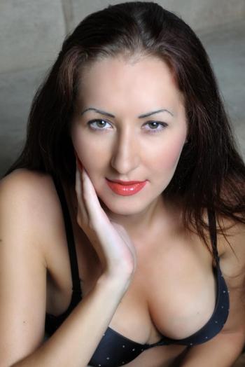 Ukrainian girl Alena,28 years old with hazel eyes and dark brown hair.