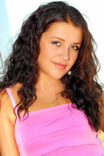 Ukrainian girl Alisa ,25 years old with blue eyes and dark brown hair.