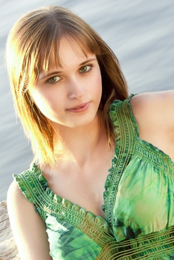 Ukrainian girl Eugeniya,26 years old with green eyes and light brown hair.