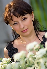 Ukrainian girl Oksana,45 years old with brown eyes and black hair.