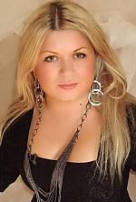 Ukrainian girl Anastacia,32 years old with green eyes and blonde hair.