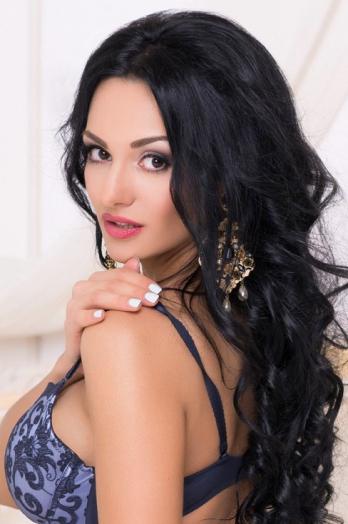 Ukrainian girl Julia,29 years old with brown eyes and black hair.