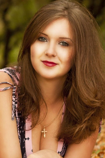 girl Nadezhda, years old with  eyes and  hair.