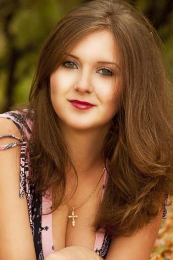 Ukrainian girl Nadezhda,26 years old with grey eyes and auburn hair.