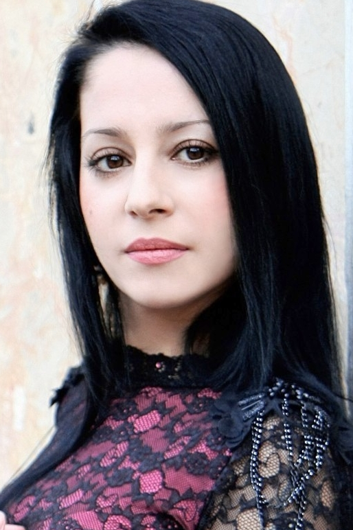Ukrainian girl Anastaciya,30 years old with brown eyes and black hair.