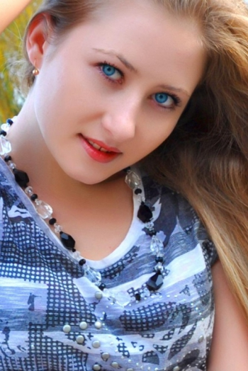 Ukrainian girl Natasha,25 years old with hazel eyes and light brown hair.