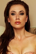 Ukrainian girl Dariya,32 years old with grey eyes and dark brown hair.