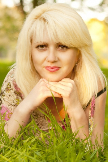 Ukrainian girl Svetlana,41 years old with brown eyes and blonde hair.