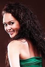 Ukrainian girl Tetyana,32 years old with green eyes and dark brown hair.
