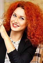 Ukrainian girl Diana,28 years old with grey eyes and red hair.