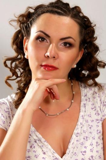 Ukrainian girl Ira,31 years old with hazel eyes and light brown hair.