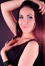 Ukrainian girl Oksana,27 years old with blue eyes and black hair.