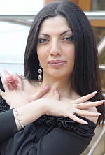 Ukrainian girl Syuzanna,33 years old with brown eyes and dark brown hair.