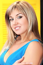 Ukrainian girl Evgeniya,32 years old with green eyes and blonde hair.