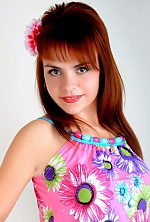 Ukrainian girl Elena,37 years old with brown eyes and red hair.